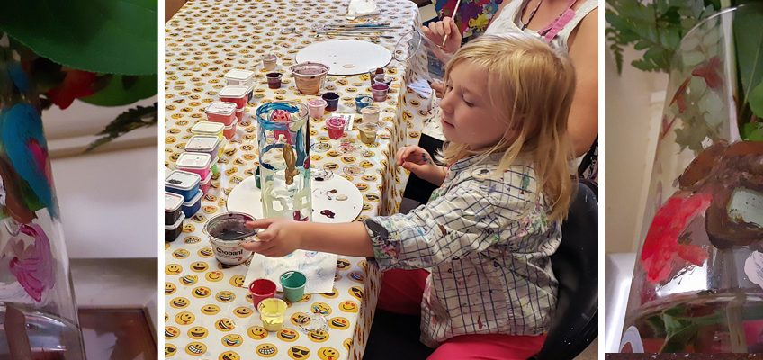 Girl painting a vase at the Service Dog Awareness event at Paint for Fun in Dover, New Hampshire