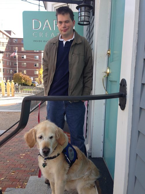 Service Dog and his owner standing outside an office